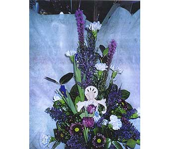 Arrangement of spring flowers w/ an angel in Sioux Falls SD, Country Garden Flower-N-Gift