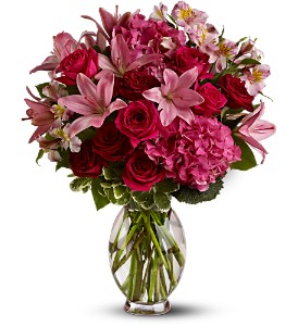 Teleflora's Head Over Heels in Traverse City MI, Cherryland Floral & Gifts, Inc.