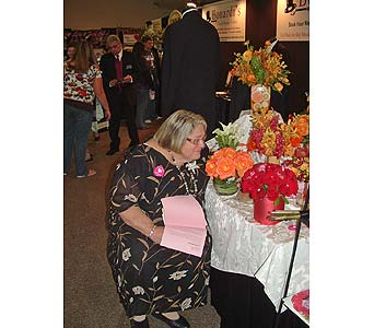 Joan smelling the roses in Worcester MA, Herbert Berg Florist, Inc.