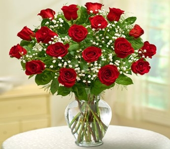 Dozen and a half roses in a vase with Gypsophilia in Sayville NY, Sayville Flowers Inc