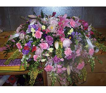 PINK AND PURPLE CASKET SPRAY in Port Chester NY, Floral Fashions