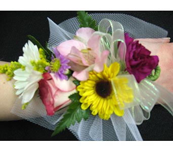 MIXED GARDEN WRISTLET  Please call for pricing in New Paltz NY, The Colonial Flower Shop