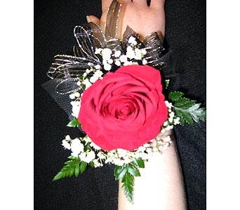 SINGLE RED ROSE WRISTLETPlease call for pricing in New Paltz NY, The Colonial Flower Shop