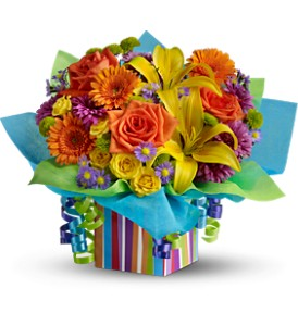 Teleflora's Rainbow Present - Deluxe in East Syracuse NY, Whistlestop Florist Inc