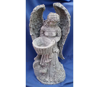 Angel with basket & watering can in Dover OH, Baker Florist, LLC
