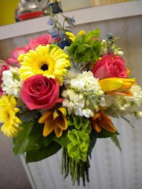 Bright bridal bouquet in Bensenville IL, The Village Flower Shop