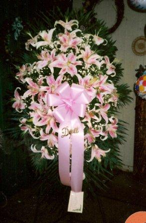 Funeral Spray with lilies in Mineola NY, East Williston Florist, Inc.