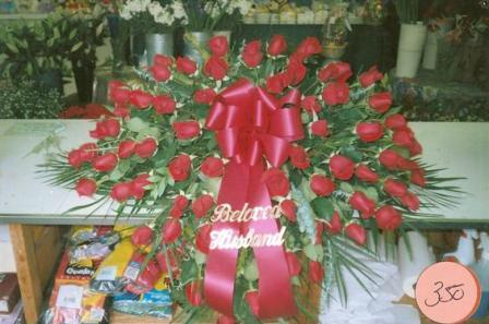 Red Casket Spray in Mineola NY, East Williston Florist, Inc.