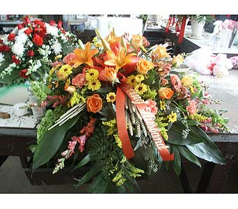 Casket Spray-Orange and Yellow in Chicago IL, Soukal Floral Co. & Greenhouses