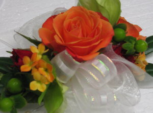 Orange Rose Wristlette with Kalanchoe Accent in Waukegan IL, Larsen Florist