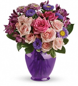Teleflora's Purple Medley Bouquet with Roses in The Woodlands TX, Rainforest Flowers