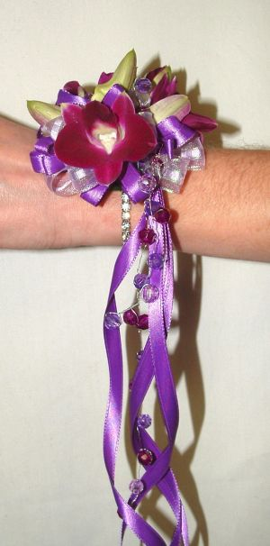 Purple Dendro Wristlet in Salisbury MD, Kitty's Flowers