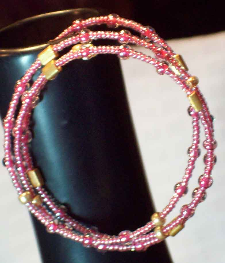 Pink Rose and Gold Spiral Bracelet in Lawrence KS, Englewood Florist