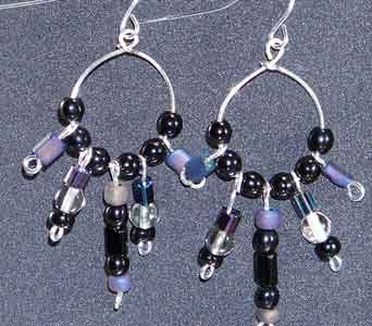 Iridescent Black Circle Earrings in Lawrence KS, Englewood Florist