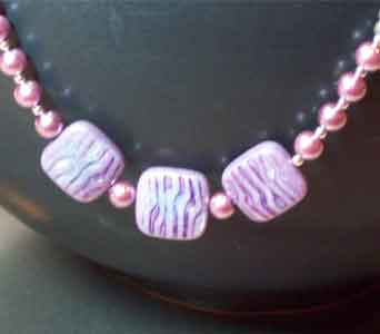 Purple Pearlized Swirl & Lavender Pearl Necklace in Lawrence KS, Englewood Florist