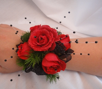 Red roses with black accents in Greenville SC, Expressions Unlimited