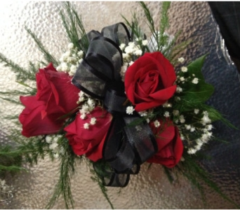 red spray rose wristlett in Wellington FL, Wellington Florist
