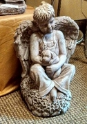 Little boy angel holding a puppy in Mankato MN, Becky's Floral & Gift Shoppe