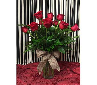 Dozen Red Roses with Christmas Greens in Creedmoor NC, Gil-Man Florist Inc.
