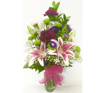 Stargazer Parade in Tulip Vase- Designed One-Sided in Wyoming MI, Wyoming Stuyvesant Floral