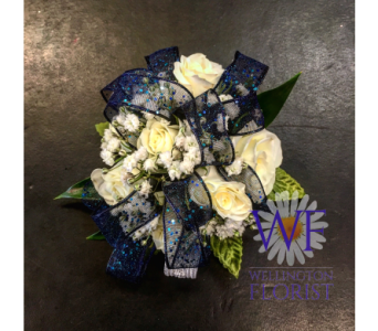 White Spray rose wristlett with navy sparkle ribbo in Wellington FL, Wellington Florist