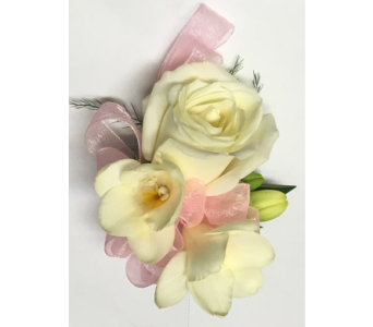 Full-Size White Rose Wrist Corsage with Freesia in Wyoming MI, Wyoming Stuyvesant Floral