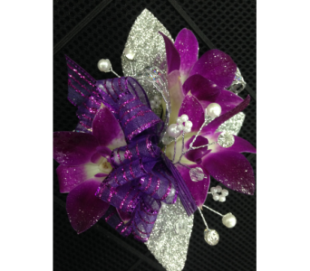 Purple dendrobium orchid wrist corsage in Gainesville FL, Floral Expressions Florist