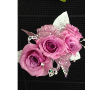 Mauve spray rose wrist corsage in Gainesville FL, Floral Expressions Florist