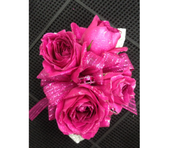 Hot pink spray rose wrist corsage in Gainesville FL, Floral Expressions Florist