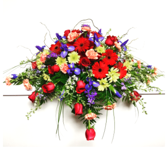 Vibrant Garden Funeral Collection Casket Spray in Wyoming MI, Wyoming Stuyvesant Floral