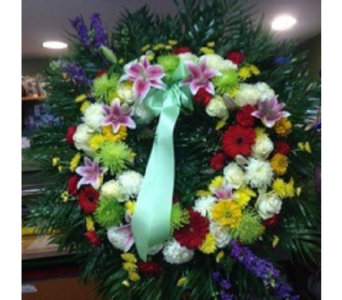Colorful Wreath of Mixed Flowers  in Manhasset NY, Town & Country Flowers