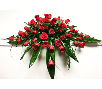 Five Dozen Red Roses Casket Spray in Wyoming MI, Wyoming Stuyvesant Floral