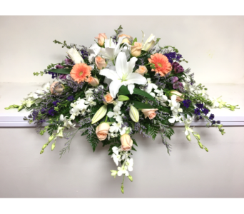 Peach, Lavender, and White Casket Spray in Wyoming MI, Wyoming Stuyvesant Floral