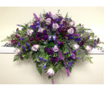 Shades of Purple Casket Spray in Wyoming MI, Wyoming Stuyvesant Floral