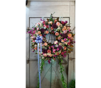 PEACHES AND PURPLES FUNERAL WREATH in Port Chester NY, Floral Fashions
