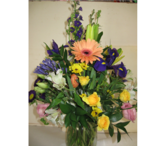 Vase with mixed seasonal spring flowers  in Blue Bell PA, Country Flower Shoppe