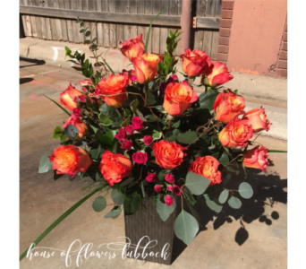 Free Spirit Roses and hot pink spray roses in Lubbock TX, House of Flowers