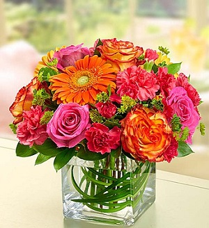 Sunset Passion in Mount Morris MI, June's Floral Company & Fruit Bouquets