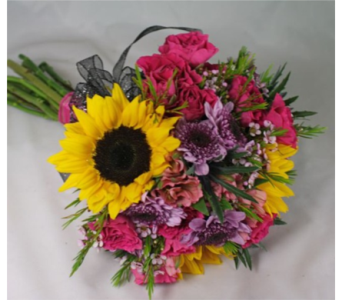 mixed flowers and colors with sunflowers handheld in Pottstown PA, Pottstown Florist