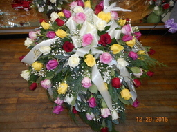 Rainbow Rose Casket Spray in Middletown OH, Flowers by Nancy
