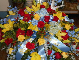 Red, Yellow & Light Blue Mix Casket Spray in Middletown OH, Flowers by Nancy