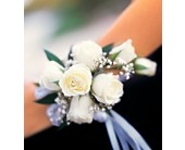 7 White Mini Roses Wristlet in Big Rapids MI, Patterson's Flowers, Inc.