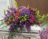 Graceful Tribute Casket Spray in Hartland, Wisconsin, The Flower Garden