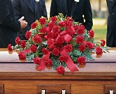 Red Regards Casket Spray in Titusville FL, Flowers of Distinction