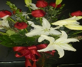 White lily with Red roses in Norwich NY, Pires Flower Basket, Inc.