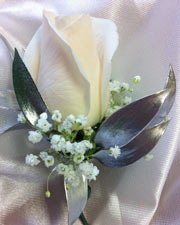 WHITE ROSE W/ SILVER LEAF BOUTONNIERE in Ossining NY, Rubrums Florist Ltd.