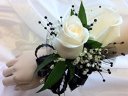 DBL WH ROSE WRIST W/ BLK PEARLS in Ossining NY, Rubrums Florist Ltd.