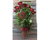 Dozen Long Stem Roses and Flame Tip Leucodendron in Ammon ID, Petal Passion