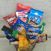 JUNK FOOD BASKET by Rubrums in Ossining NY, Rubrums Florist Ltd.
