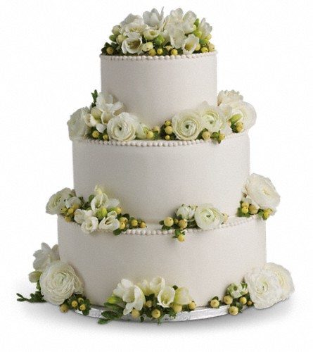 Freesia and Ranunculus Cake Decoration in Beaumont TX, Blooms by Claybar Floral